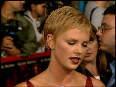 Charlize Theron at the Premiere of 'The Devil's Advocate' at the Mann Village Theatre in Westwood California on October 13 1997
