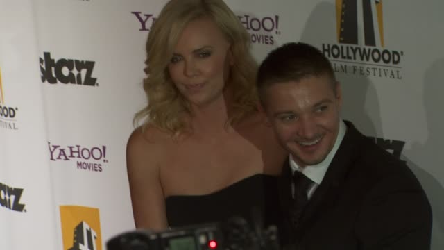 Charlize Theron Jeremy Renner at the 13th Annual Hollywood Awards Gala at Beverly Hills CA