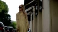 Charlotte Groeneveld 'The Fashion Guitar' wears sunglasses a yellow lace dress a blue bag outside the Valentino show during Paris Fashion Week Haute...