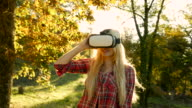 Charming girl with Vr outdoors