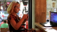 Charming woman in cafe bar using smart phone