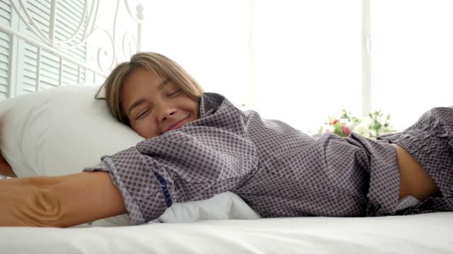 Charming young girl sleeping hugging pillow