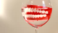 chattering teeth in glass of water