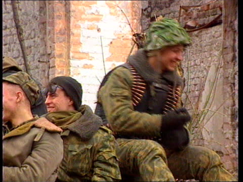 Chechen ceasefire CHECHEN Grozny MS Russian APC parked loaded with Russian soldiers CMS Russian soldier on top of APC MS Russian soldiers chatting MS...