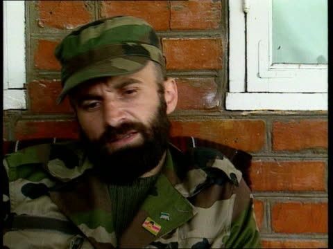 War aftermath MS Shamil Basayev standing 2 SHOT Basayev and McDonnell 2 SHOT Ditto CS Badge on jacket showing picture of Dudayev CMS Shamil Basayev...