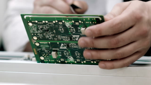 Checking mother board on SMT line