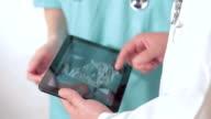 Checking ultrasound on digital tablet