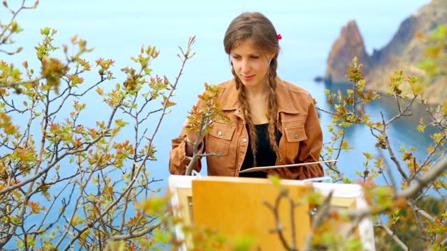 cheerful artist on the beautiful wild coast