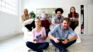 Cheerful Group Of Young Friends Playing Video Games