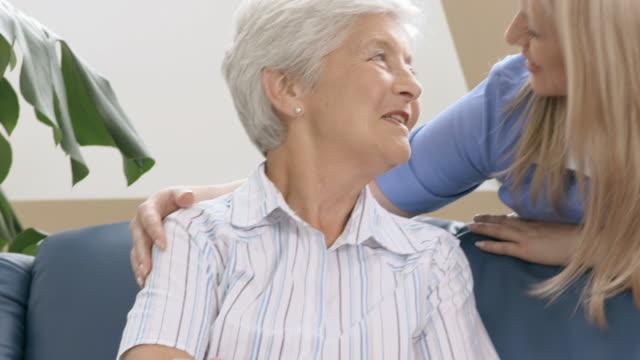 HD: Cheerful Nurse At Rest Home