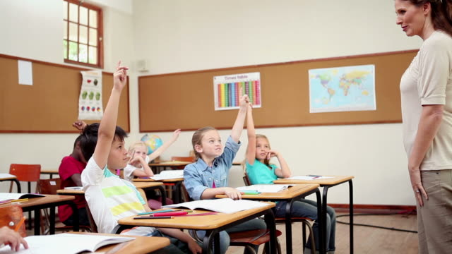 Cheerful pupils raising their fingers
