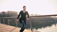 WS TS Cheerful Student Crossing The Bridge
