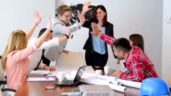 DOLLY: Cheerful young professionals in meeting room
