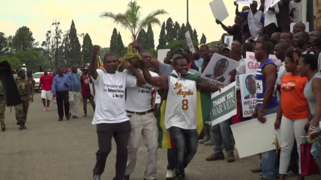 Cheering crowds welcoming back exiled former Zimbabwe vicePresident Emmerson Mnangagwa who will be installed as President following the resignation...