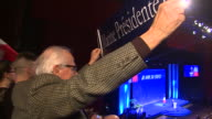 Cheering Marine Le Pen supporters holding up banners and waving French flags during her Presidential campaign speech in Lyon