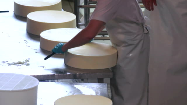 Cheese Blocks Being Prepared For Storing
