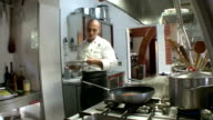 MS Chef adding ingredients into pan / Montepulciano, Tuscany, Italy