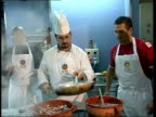 Chef Aldo Zilli running pasta cooking course INT Zilli teaching Simmons how to knead pasta dough ZOOM IN to Zilli SOT CS Sieve of vegetables over...