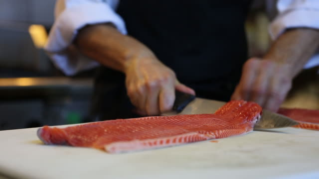 Chef cutting salmon seafood cinemagraph