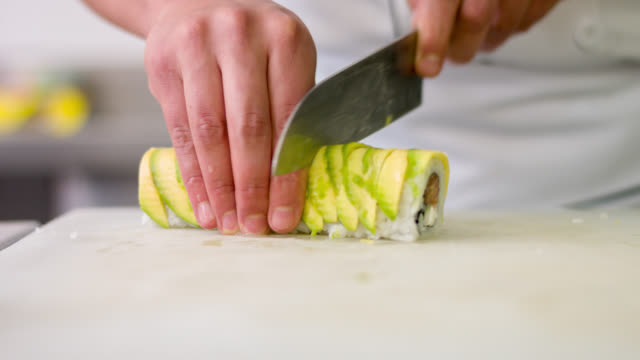 Chef cutting sushi