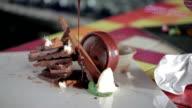 Chef decorating lava chocolate cake