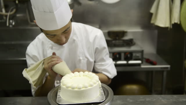 MS Chef decorating on birthday cake / Kyoto, Japan