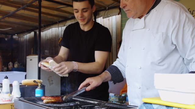 Chef Making Burgers at Outdoor Market
