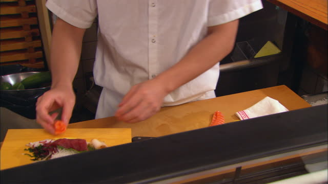 CU, Chef preparing Sashimi, mid section