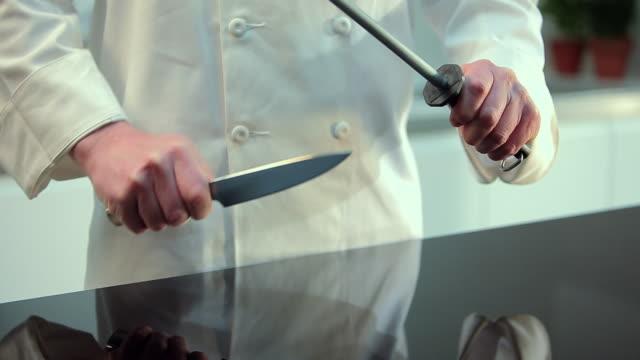Chef sharpening kitchen knife