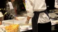 Chef stirring sauce.
