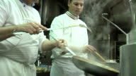 SLO MO, CU, Chef tossing pasta from frying pan