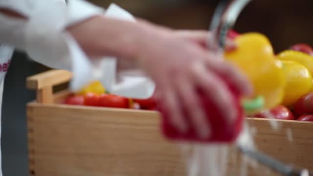 Chef washing fresh paprica
