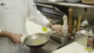 MS Chefs cooking in commercial kitchen / Miami, Florida, USA