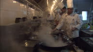 Chefs prepare food in a restaurant kitchen in Beijing.