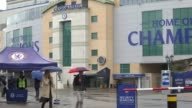 Chelsea accused of failing disabled fans ENGLAND London Stamford Bridge Chelsea Football Club logo PULL People with umbrellas along outside Stamford...