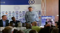Chelsea FC Press Conference as Ashley Cole signs to the club Mourinho and Cole pose for photocall with Chelsea strip shirt sponsored by Samsung...