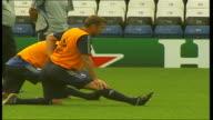 Chelsea FC training Andrei Shevchenko as next to Paulo Ferreir stretching