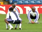 Chelsea FC training session ENGLAND London Stamford Bridge EXT Chelsea team warming up on pitch with Jose Mourinho Players stretching and jogging...