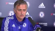 Jose Mourinho press conference ENGLAND Surrey Cobham INT Sign 'Chelsea Football Club' on wall / Jose Mourinho arriving and taking seat / Jose...