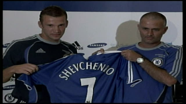 London INT Chelsea Manager Jose Mourinho and new signing Andriy Shevchenko posing for photocall holding Chelsea shirt Chelsea players training