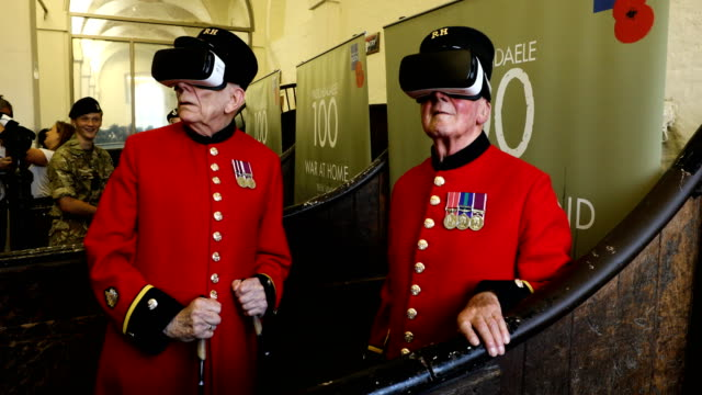 Chelsea Pensioners Bill Hunt and John Kidman pose wearing VR goggles during a photocall at the Royal British Legion's Household Cavalry museum on...