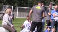 Chelsea players Diego Costa and David Luiz greet fans at team training ahead of their FA Cup final clash against Arsenal on Saturday
