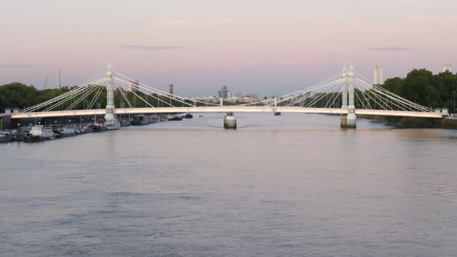T/L Chelsea/Albert Bridge and the Thames, day to night, London, England