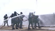 Chemical Crew in Gas Mask Flowing Water