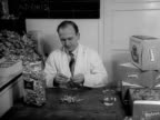 A chemist tests the taste and quality of sweets in the test area of a sweet factory