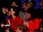 Cherie Blair and Pauline Prescott sit clapping and dressed in red in audience of Labour Party conference Brighton 28 Sep 00