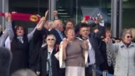 Prosecutors to bring criminal charges T26041601 TX Cheshire Warrington GVs Family members of Hillsborough Disaster victims singing 'You'll never walk...