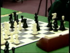 Chess matches being played in a local chess league ENGLAND Croydon INT Various views of chess boards with matches in progress