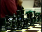 Chess matches being played in a local chess league More close shots of chess pieces