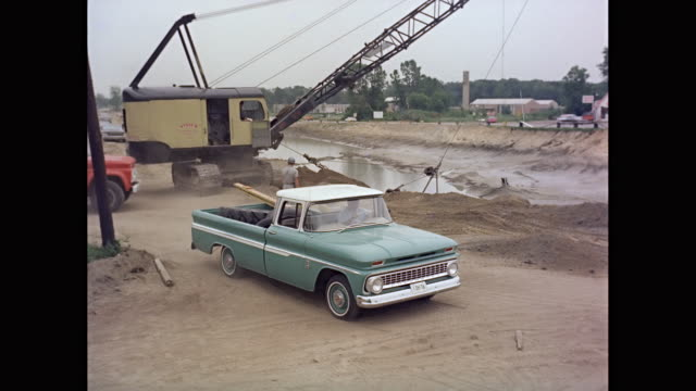 WS 1963 Chevrolet truck moving at construction site / United States